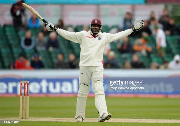 West Indies captain Chris Gayle celebrates reaching 50 runs as West Indies follow on in the 2nd Test match between England and West Indies at the...