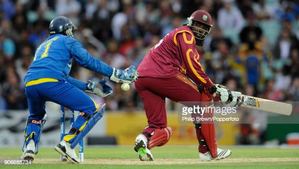 West Indies captain Chris Gayle glances the ball past Sri Lanka's wicketkeeper captain Kumar Sangakkara during his innings of 63 not out in the ICC...