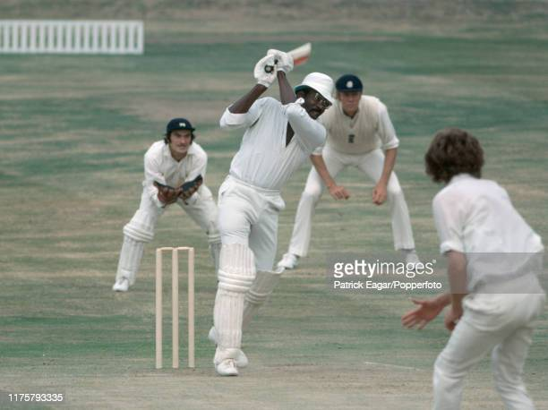 West Indies captain Clive Lloyd hits out at a delivery from England bowler Bob Willis during the 4th Test match between England and West Indies at...