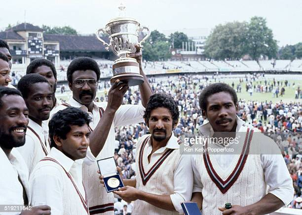 West Indies captain Clive Lloyd holding the trophy surrounded by his teammates after their victory over England in the Prudential World Cup Final at...