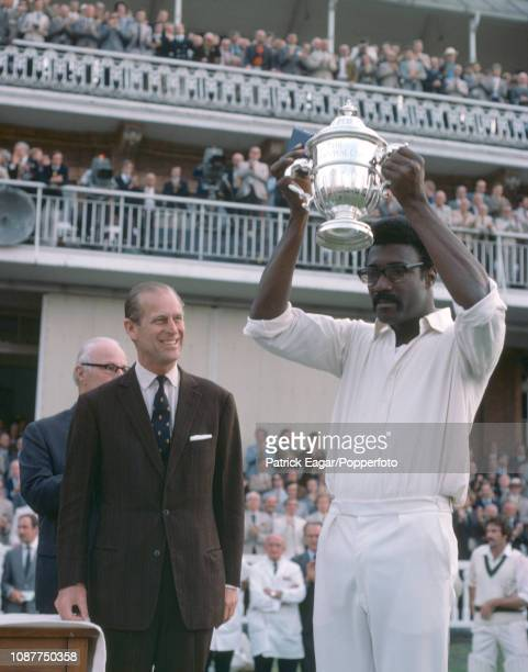 West Indies captain Clive Lloyd lifts the Prudential World Cup after it was presented to him by HRH Prince Philip after the World Cup Final between...