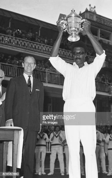 West Indies captain Clive Lloyd shows the Prudential World Cup to the fans after receiving it from the smiling Duke of Edinburgh President of the MCC...