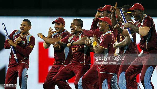 West Indies' captain Darren Sammy and teammates celebrate after victory during the ICC World T20 cricket Final between Sri Lanka and West Indies at R...