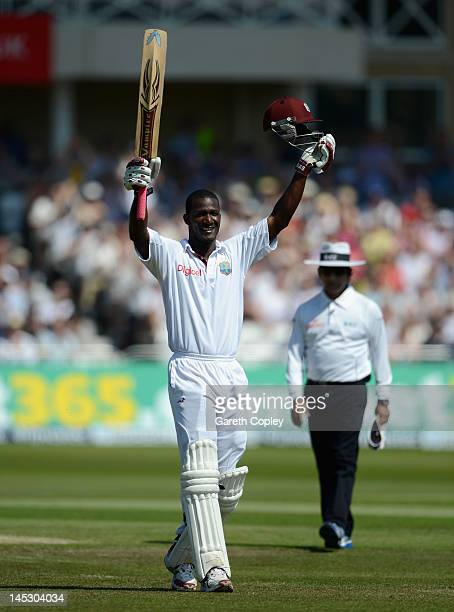 West Indies captain Darren Sammy celebrates reaching his century during day two of the second Test match between England and the West Indies at Trent...