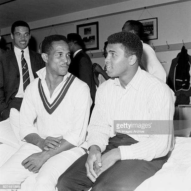 West Indies captain Garfield Sobers chats to World Heavyweight Boxing Champion Muhammad Ali in the dressing room