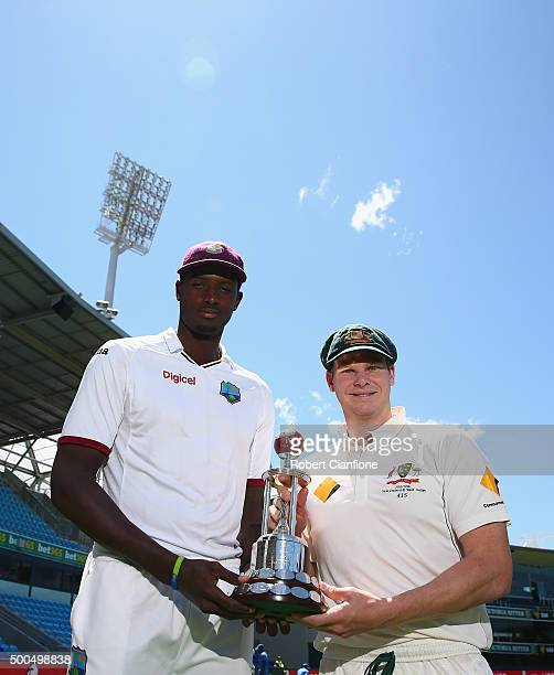 West Indies captain Jason Holder and Australian captain Steve Smith pose with the Frank Worrell trophy at Blundstone Arena on December 9 2015 in...