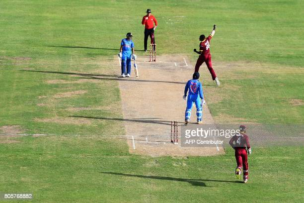 West Indies' captain Jason Holder celebrates after bowling out India's Umesh Yadav during the fourth One Day International match between West Indies...