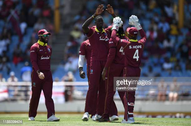 West Indies captain Jason Holder celebrates dismissing Adil Rashid of England during the Fifth One Day International match between England and West...