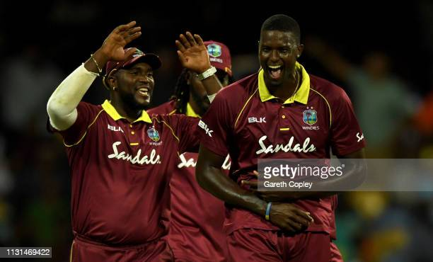 West Indies captain Jason Holder celebrates dismissing Tom Curran of England during the 2nd One Day International match between the West Indies and...