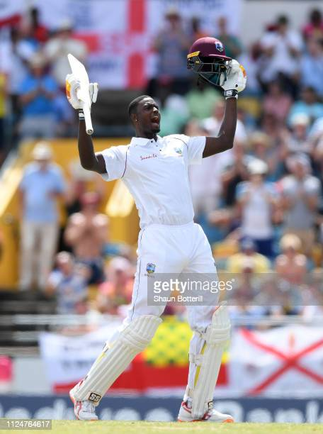 West Indies captain Jason Holder celebrates reaching his 100 during Day Three of the First Test match between England and West Indies at Kensington...