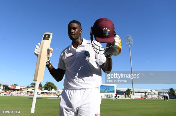 West Indies captain Jason Holder celebrates reaching his 200 during Day Three of the First Test match between England and West Indies at Kensington...