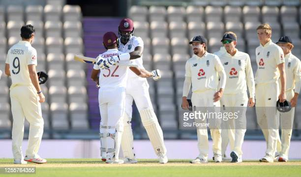 West Indies captain Jason Holder celebrates with John Campbell after winning the 1st #RaiseTheBat Test match at The Ageas Bowl on July 12, 2020 in...