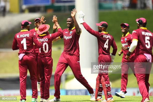 West Indies' captain Jason Holder celebrates with teammates after dismissing India's captain Virat Kohli during the third One Day International match...