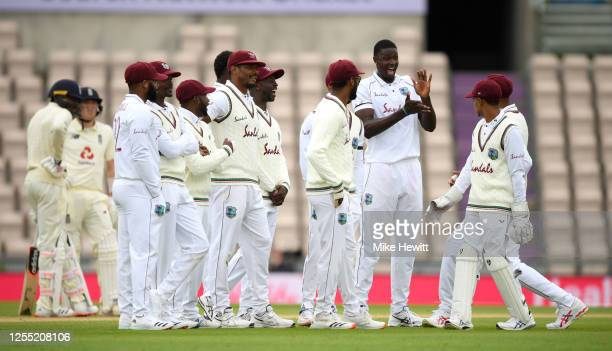 West Indies captain Jason Holder celebrates with teammates dismissing Jofra Archer of England during day two of the 1st #RaiseTheBat Test match at...