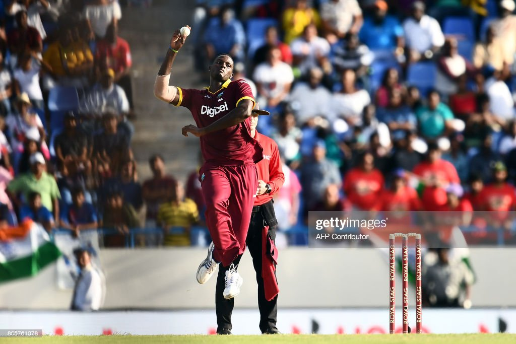 West Indies' captain Jason Holder delivers a ball during the fourth One Day International (ODI) match between West Indies and India at the Sir Vivian Richards Cricket Ground in St. John's, Antigua, on July 2, 2107. West Indies defeated India by 11 runs as the visitor lead the five-match-ODI-series 2-1. / AFP PHOTO / Jewel SAMAD