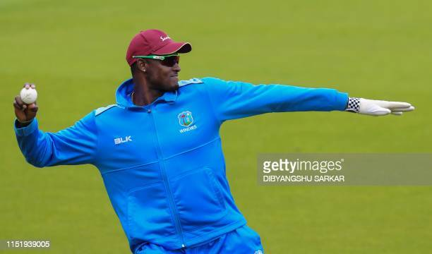 West Indies' captain Jason Holder fields a ball during a training session at Old Trafford in Manchester, northwest England on June 26 ahead of their...