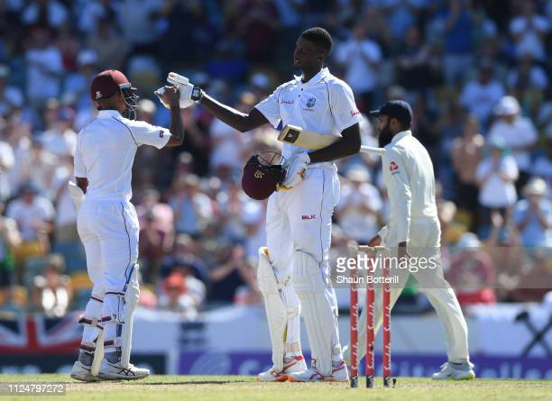 West Indies captain Jason Holder is congratulated by teammate Shane Dowrich after reaching his 150 during Day Three of the First Test match between...