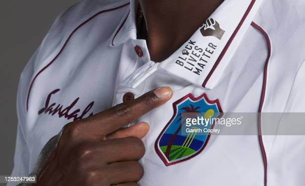 West Indies captain Jason Holder points at the Black Lifes Matter massage on his shirt as he poses for a portrait at Emirates Old Trafford on June...