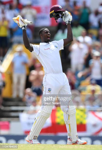 West Indies captain Jason Holder reaches his 100 during Day Three of the First Test match between England and West Indies at Kensington Oval on...