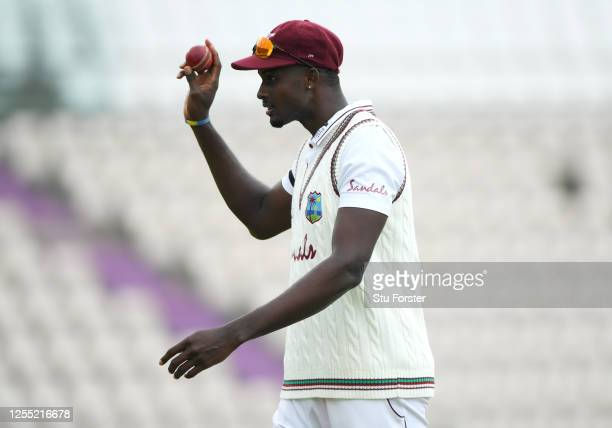 West Indies captain Jason Holder salutes the dressing room as he leaves the field after taking 6 wickets during day two of the 1st #RaiseTheBat Test...