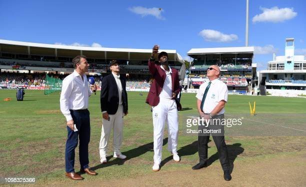 West Indies captain Jason Holder tosses the coin alongside England captain Joe Root Skysports Michael Atherton and match referee Jeff Crowe ahead of...