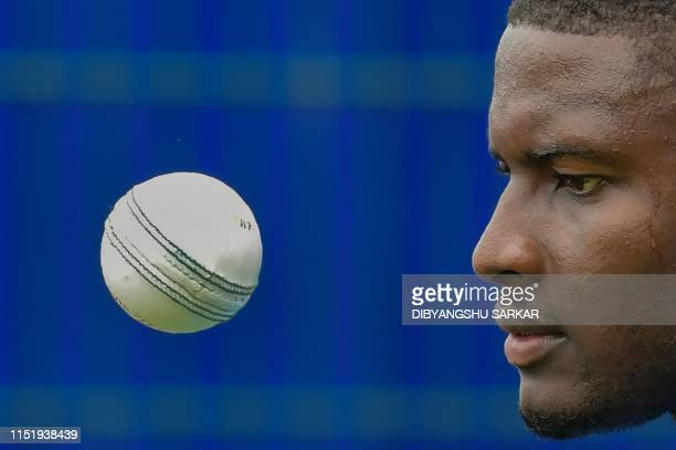 West Indies' captain Jason Holder watches a ball during a training session at Old Trafford in Manchester northwest England on June 26 ahead of their...