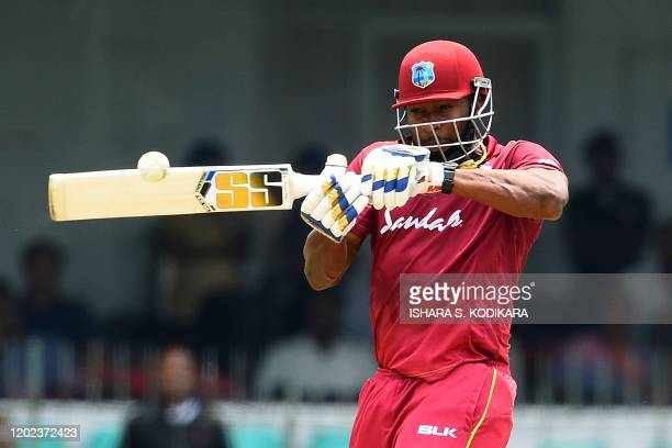West Indies' captain Kieron Pollard plays a shot during the first one day international cricket match between Sri Lanka and West Indies at the...