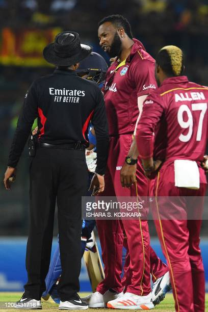 West Indies' captain Kieron Pollard speaks with the umpire Raveendra Wimalasiri during the second Twenty20 international cricket match of a twomatch...