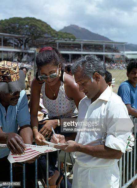 West Indies captain Rohan Kanhai signing autographs during the 3rd Test match between West Indies and Australia at the Queen's Park Oval, Port of...