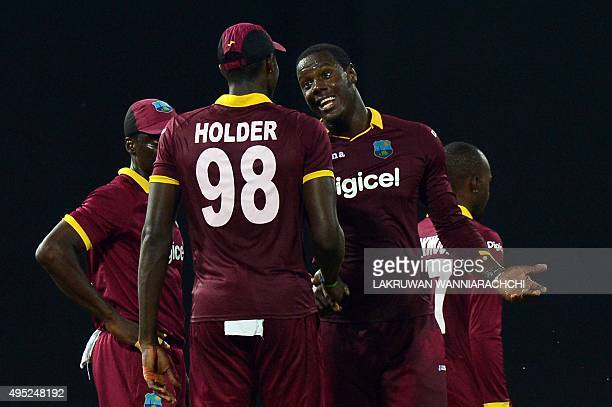West Indies' Carlos Brathwaite celebrates with teammates after dismissing Sri Lanka's Lahiru Thirimanne during the first One Day International...