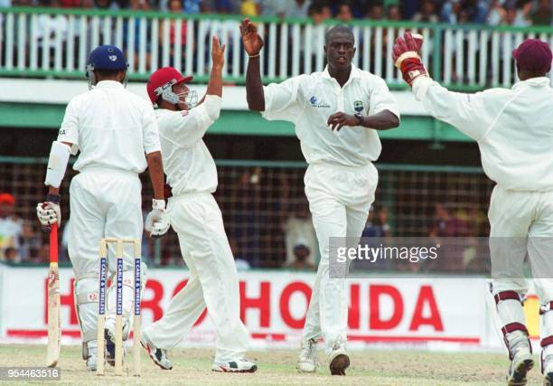 West Indies Carmeron Cuffy celebrates the lbw dismissal of Sanjay Bangar on the fourth day of the First Cable Wireless Test at Bourda Guyana in...