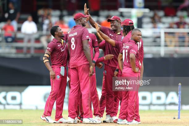 West Indies celebrate the wicket of Shikhar Dhawan during the third MyTeam11 ODI between the West Indies and India at the Queen's Park Oval on August...