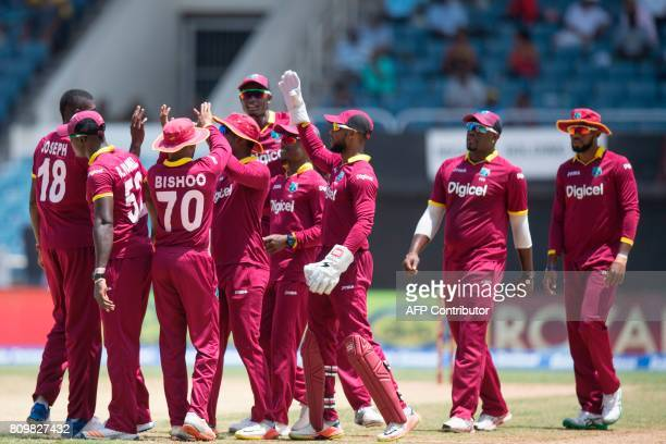 West Indies celebrates outing India's Shikhar Dhawan during the fifth One Day International match between West Indies and India at the Sabina Park...