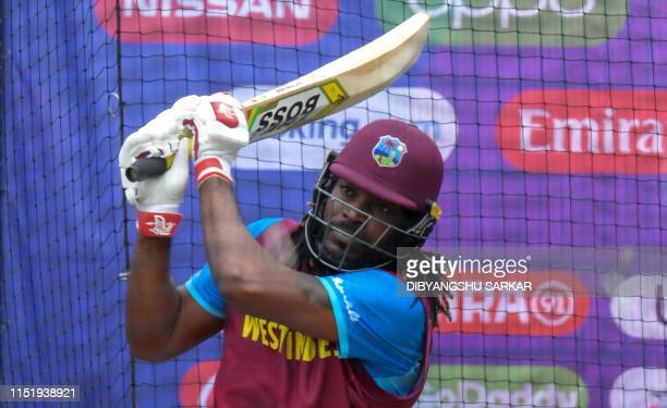 West Indies' Chris Gayle bats in the nets during a training session at Old Trafford in Manchester, northwest England on June 26 ahead of their 2019...