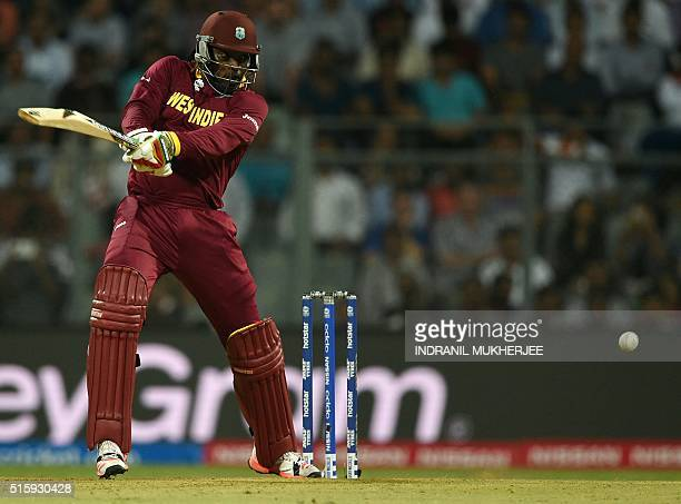 West Indies Chris Gayle plays a shot during the World T20 cricket tournament match between England and West Indies at The Wankhede Cricket Stadium in...