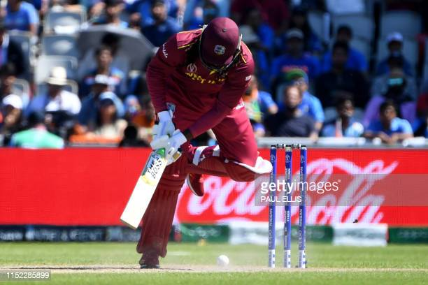 West Indies' Chris Gayle reacts whilst batting during the 2019 Cricket World Cup group stage match between West Indies and India at Old Trafford in...