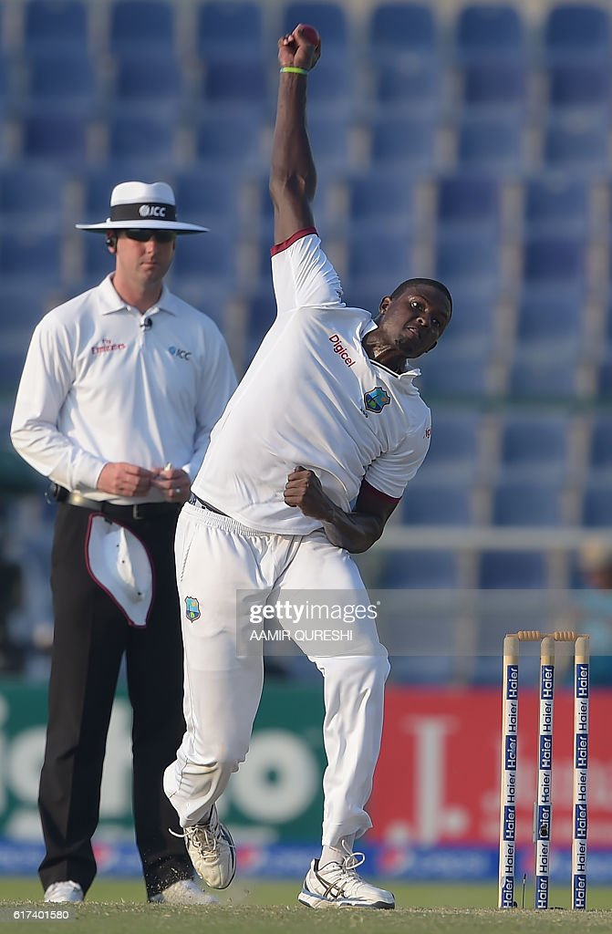 West Indies' cricket captain Jason Holder delivers the ball on the third day of the second Test between Pakistan and the West Indies at the Sheikh Zayed Cricket Stadium in Abu Dhabi on October 23, 2016. Openers Azhar Ali and Sami Aslam hit half-centuries to help Pakistan strenghten their grip on the third day of the second Test against West Indies in Abu Dhabi. Ali was batting on 52 and Asad Shafiq five not out to take Pakistan to 114-1, having an overall lead of 342 after dismissing West Indies for 224 in their first innings. / AFP / AAMIR