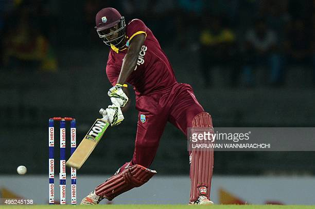 West Indies cricket captain Jason Holder plays a shot during the first One Day International match between Sri Lanka and the West Indies at the R...