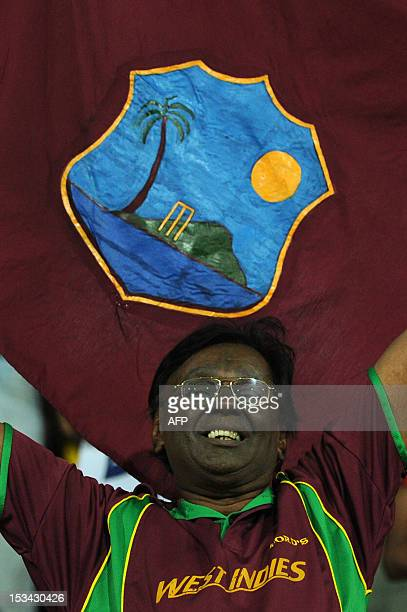 A West Indies cricket fan cheers during the ICC Twenty20 Cricket World Cup's semifinal match between Australia and West Indies at the R Premadasa...