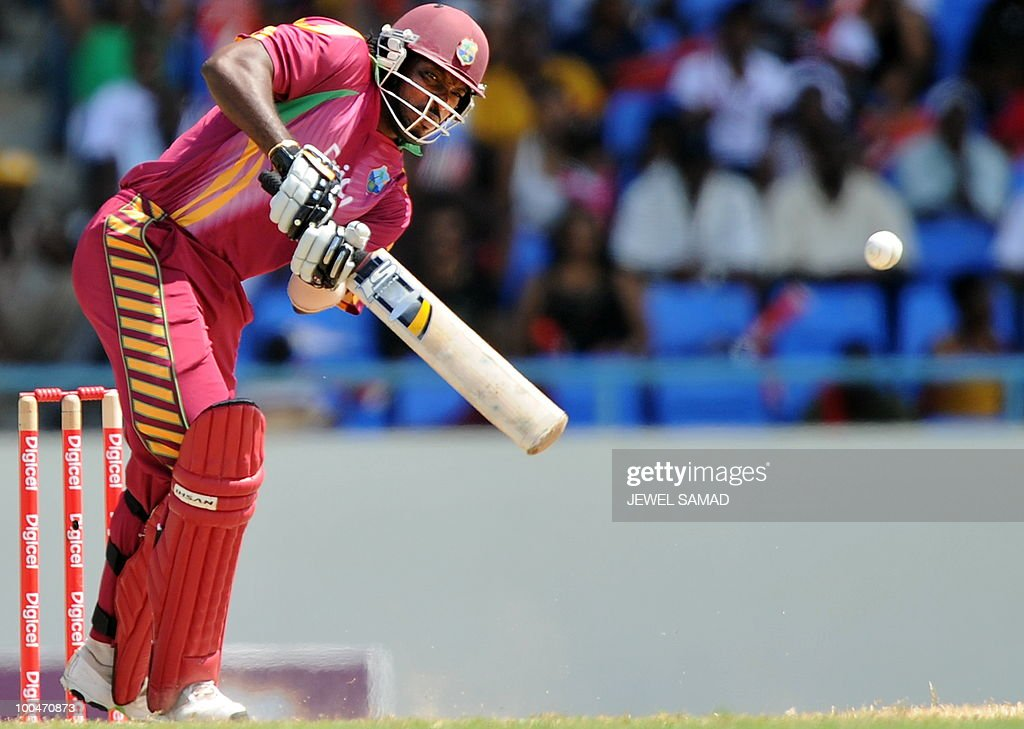 West Indies cricket team captain Chris Gayle hits a boundary off South African bowler Lonwabo Tsotsobe during the second One Day International match between West Indies and South Africa at the Sir Vivian Richards Stadium in St John's on May 24, 2010. Batting first, South Africa scored 300-runs at the end of their innings. AFP PHOTO/Jewel Samad
