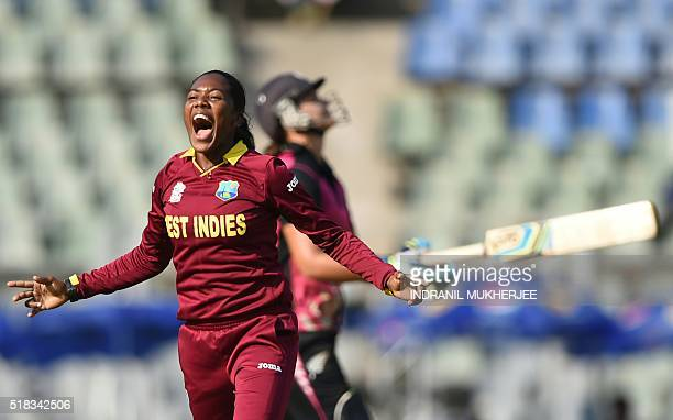 West Indies cricketer Afy Fletcherreacts after taking the wicket of New Zealand captain Suzie Batesduring the World T20 women's semifinal match...