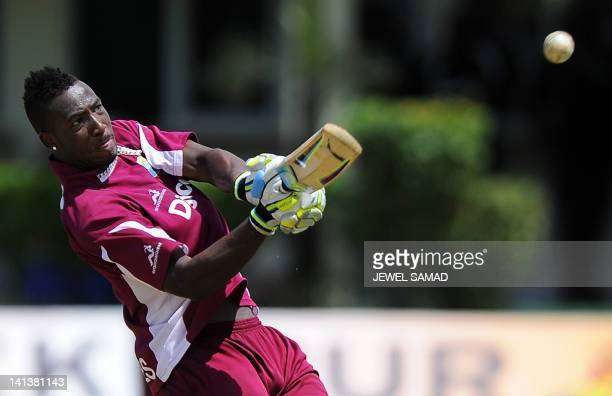 West Indies cricketer Andre Russell hits the ball during a practice session at the Arnos Vale Ground in Kingstown on March 15 2012 West Indies will...