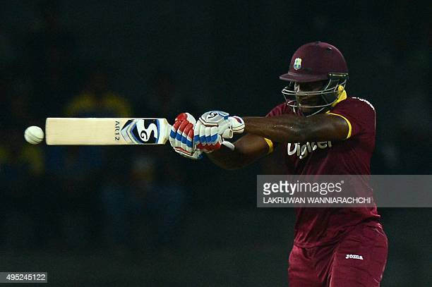 West Indies Cricketer Andre Russell plays a shot during the first One Day International match between Sri Lanka and the West Indies at the R...