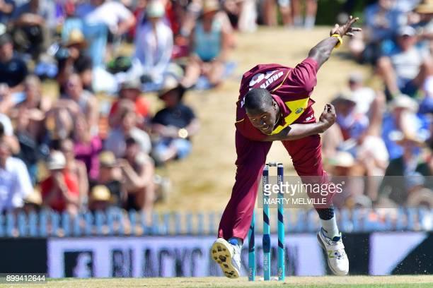 West Indies cricketer Carlos Brathwaite bowls during the first Twenty20 international cricket match between New Zealand and the West Indies at Saxton...