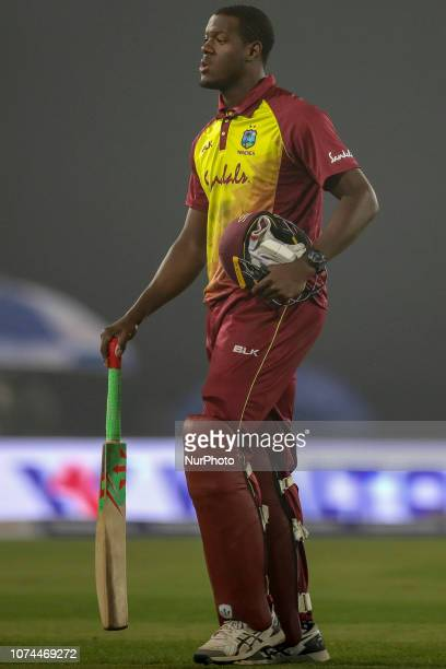 West Indies cricketer Carlos Brathwaite walks off the field after being dismissed during the second T20 match between Bangladesh against West Indies...