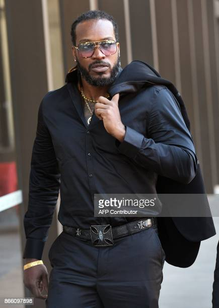 West Indies cricketer Chris Gayle arrives at the New South Wales Supreme Court in Sydney on October 25 2017 Massage therapist Leanne Russell said she...