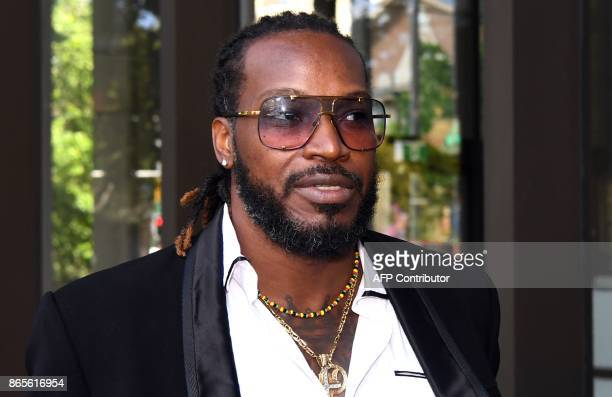 West Indies cricketer Chris Gayle leaves the New South Wales Supreme Court in Sydney on October 24 2017 Gayle has denied exposing his genitals to a...