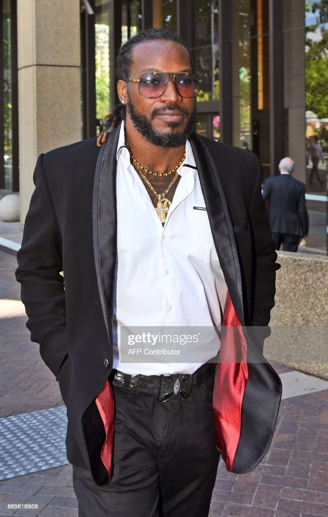 West Indies cricketer Chris Gayle leaves the New South Wales Supreme Court in Sydney on October 24, 2017. Gayle has denied exposing his genitals to a massage therapist, claiming an Australian media group set out to 'destroy' him in a defamation action Monday. They claimed the all-rounder exposed himself to a female masseuse in a dressing room at the 2015 World Cup in Sydney and 'indecently propositioned' her. /