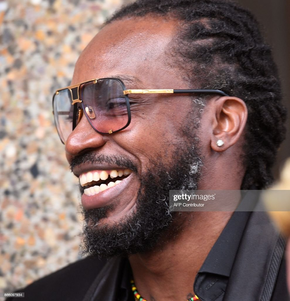 West Indies cricketer Chris Gayle leaves the New South Wales Supreme Court in Sydney on October 25, 2017. Massage therapist Leanne Russell said she 'cried uncontrollably' after star West Indian cricketer Chris Gayle allegedly exposed himself to her, telling a Sydney court it left her 'very upset'. Gayle is suing Fairfax Media newspapers The Sydney Morning Herald, The Age and The Canberra Times over a series of stories in January last year detailing the lurid accusations. WEST