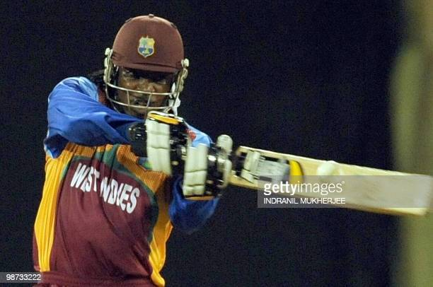 West Indies cricketer Chris Gayle plays a shot during the warm-up match between West Indies and New Zealand at the Providence Stadium in Guyana on...
